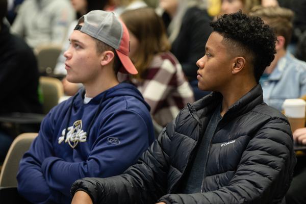 Two College of Business students listening in class