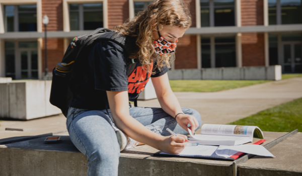 A student studying outside