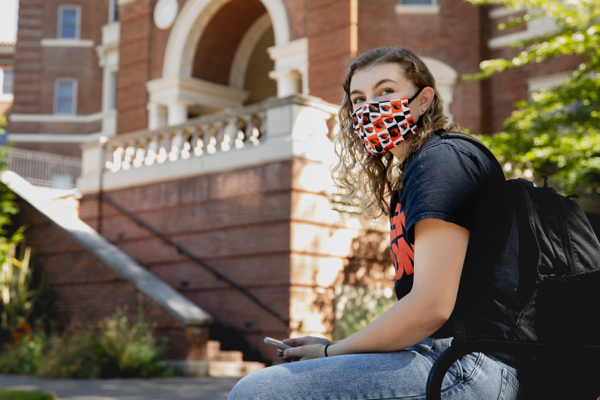 A student wearing a mask  sits in front of Weatherford