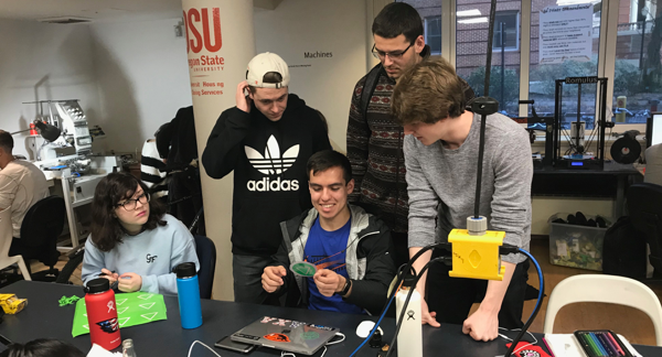 A group of OSU College of Business students working in the DAMlab