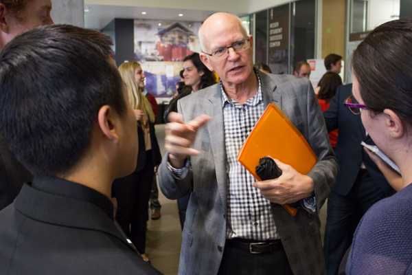 A mentor talks with College of Business students at the Career Fair