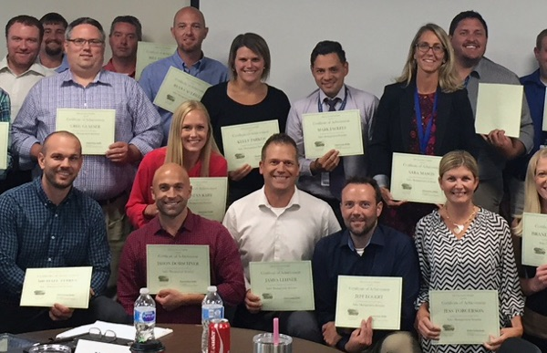 Group of Gallo employees with their College of Business certificates