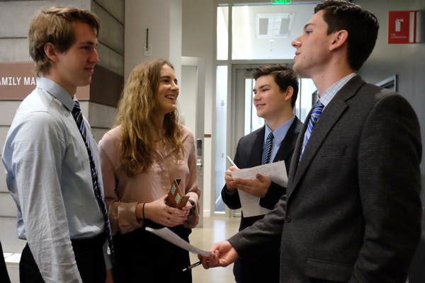 A group of College of Business students networking