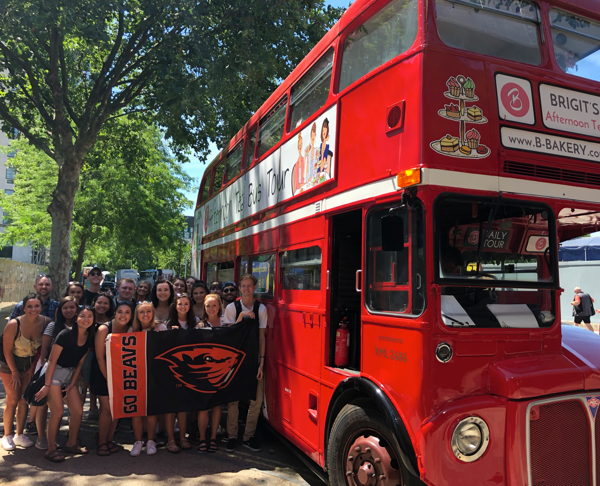 Study abroad students by a British bus