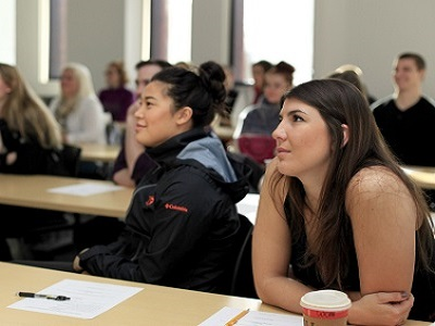 College of Business students listening in class