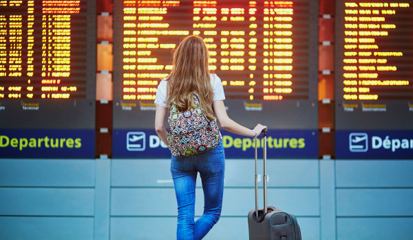 A woman stands in an airplane terminal